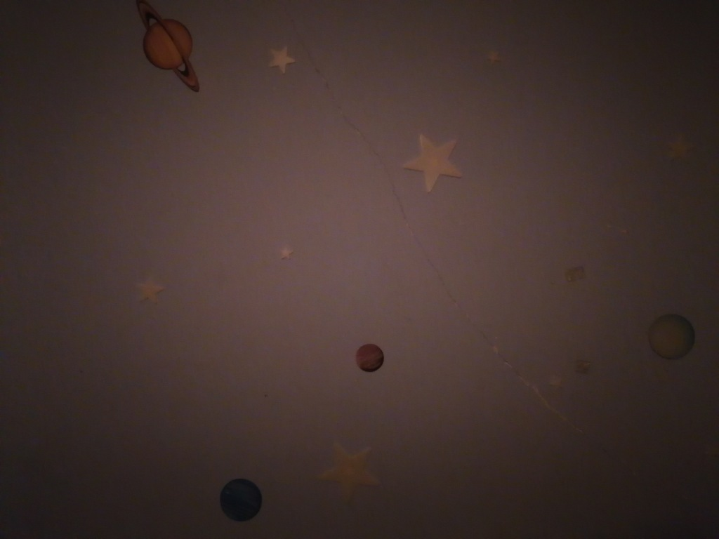 a wall decor of planets and stars