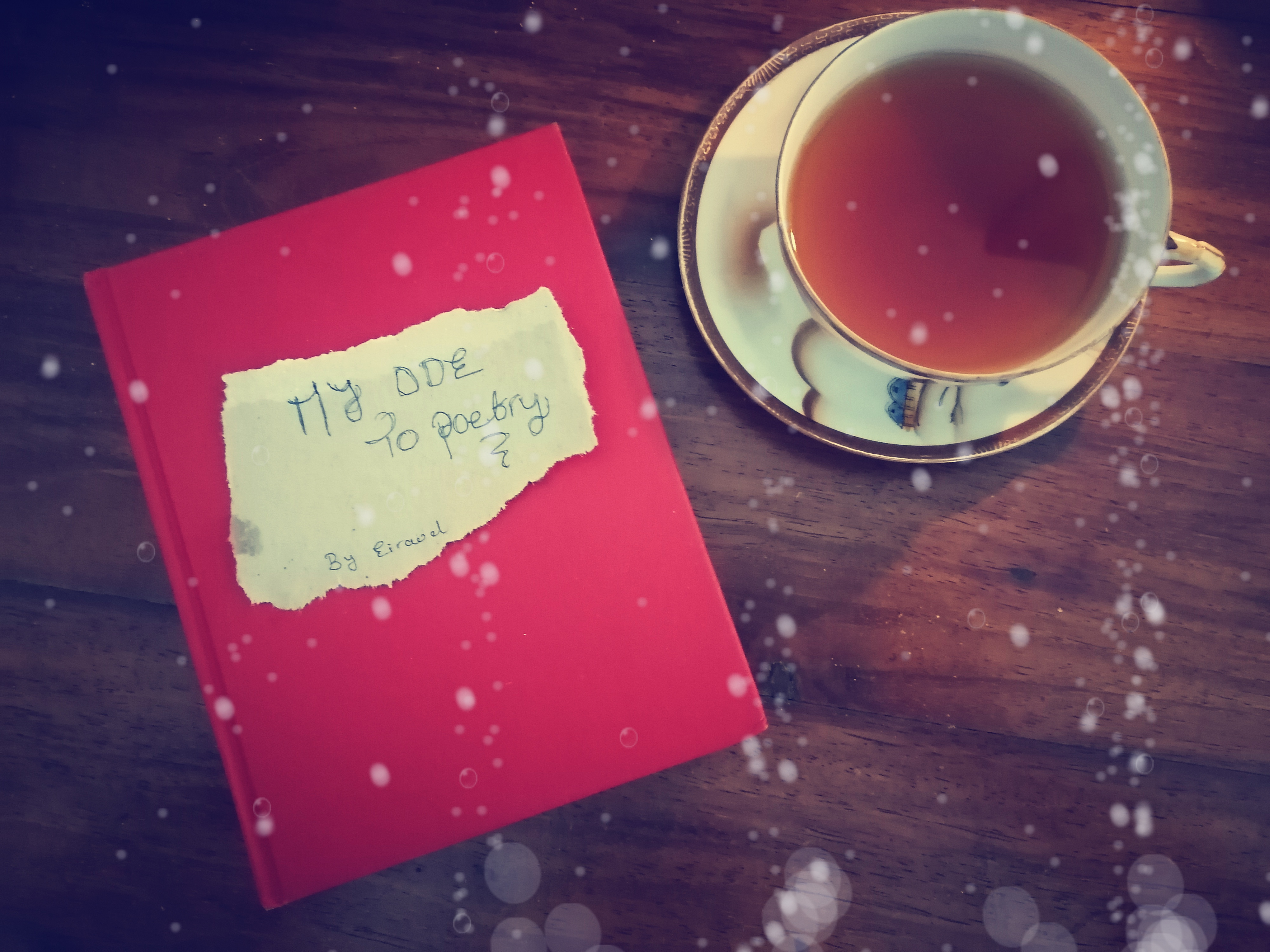 Red book and cup of tea and saucer